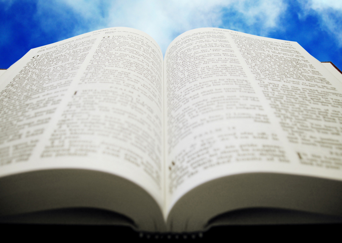 open Bible with sky background